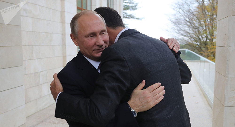 Vladímir Putin en una reunión con Bashar Asad
