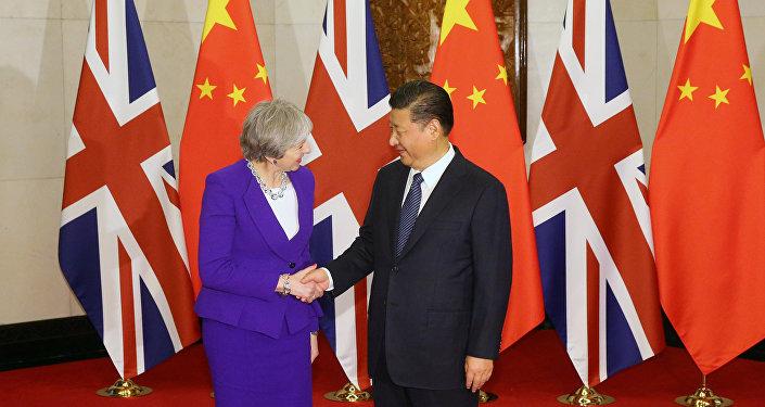 Theresa May, primera ministra del Reino Unido, y Xi Jinping, presidente de China