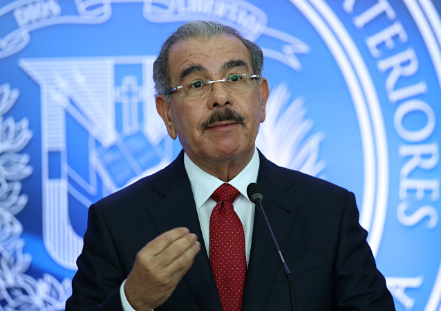 Dominican Republic's President Danilo Medina talks to the media after attending a meeting in Santo Domingo