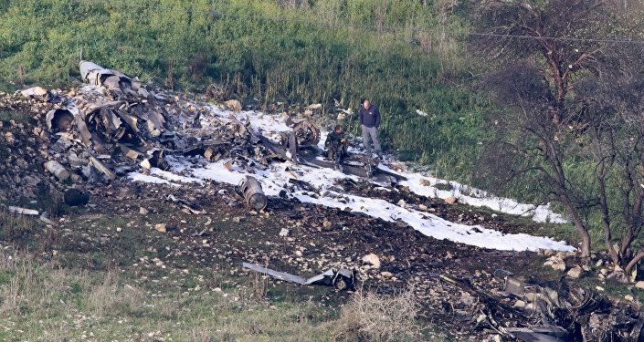 Los restos del caza F-16 israelí