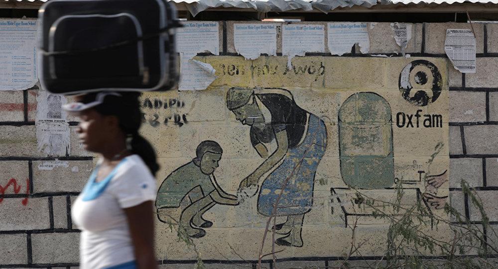 Logo de Oxfam en la ciudad de Puerto Príncipe, Haití