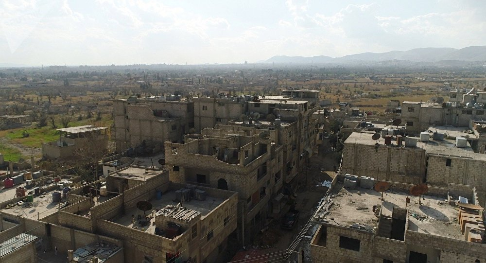 Un corredor humanitario entre Damasco y Guta Oriental en la zona del campo para los refugiados Wafidin