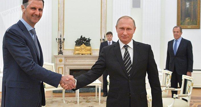 Presidente de Siria, Bashar Asad, y presidente de Rusia, Vladímir Putin, durante el encuentro en el Kremlin, el 21 de octubre, 2015