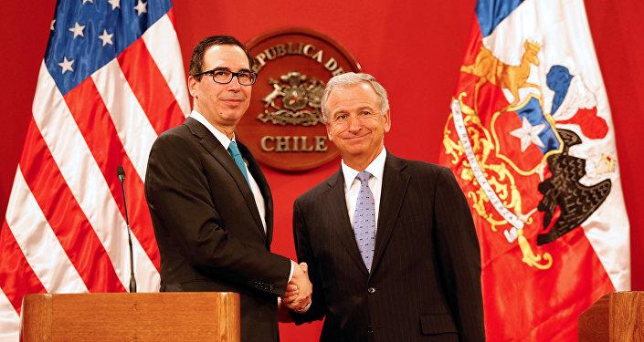 Secretario del Tesoro de EEUU, Steven Mnuchin, y ministro de Hacienda de Chile, Felipe Larraín