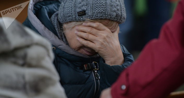 Familiar de uno de los desaparecidos en el incendio en el centro comercial en Kémerovo