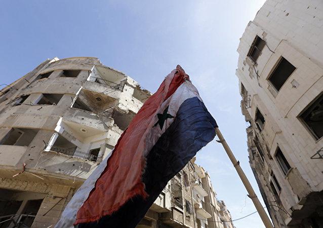 La bandera de Siria en Guta Oriental
