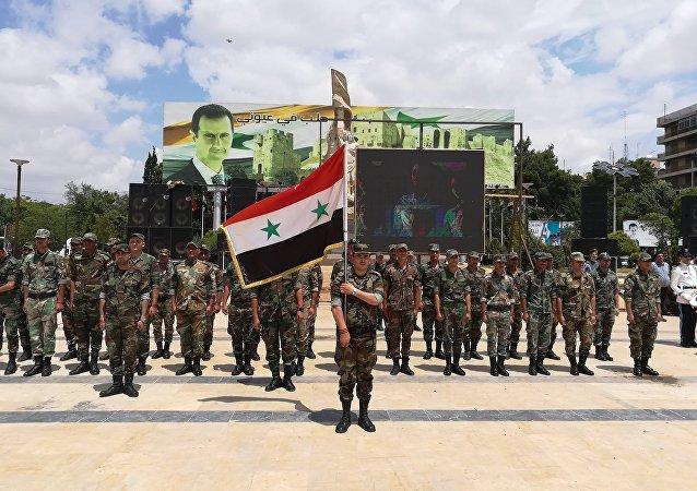 Desfile del Día de la Victoria en Alepo