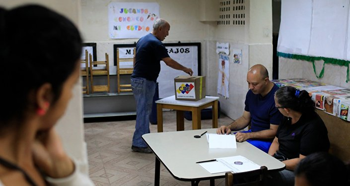 A Venezuelan casts his vote at a polling station during the presidential election in Caracas, Venezuela