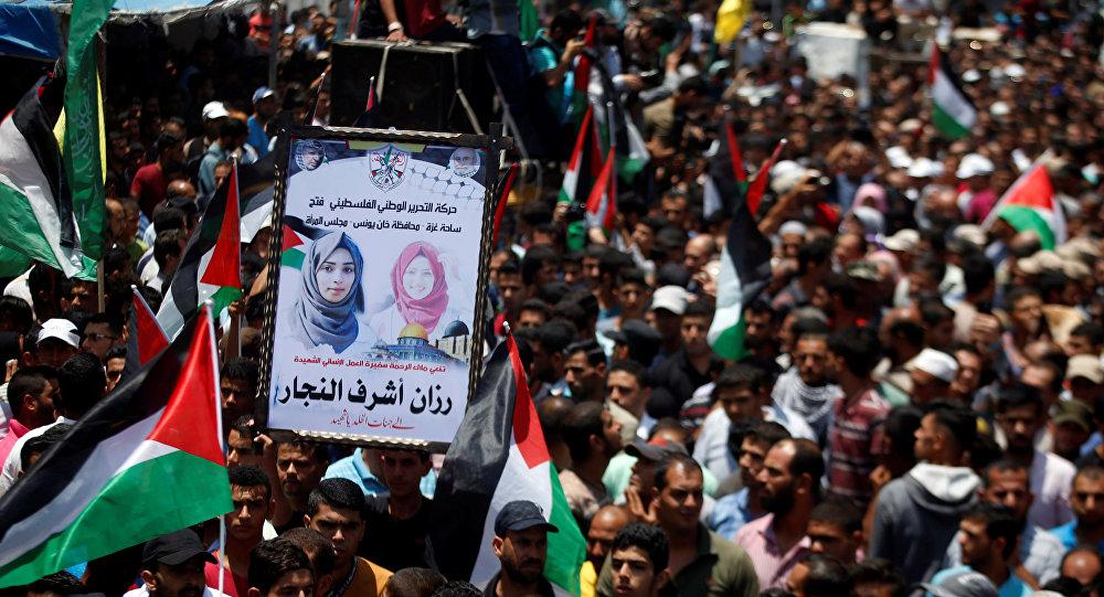 Miles de palestinos despiden a la voluntaria médica muerta en Gaza ...