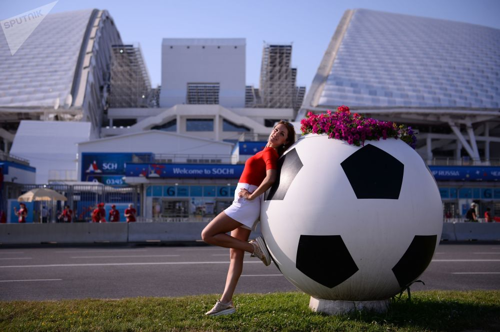 A female fan posing at the Fisht stadium in the Olympic Park before the World Cup group stage match between Portugal and Spain.