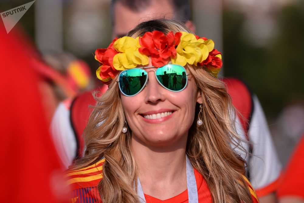 A female fan of Spain's national team smiles ahead of a group stage World Cup match between Spain and Portugal.