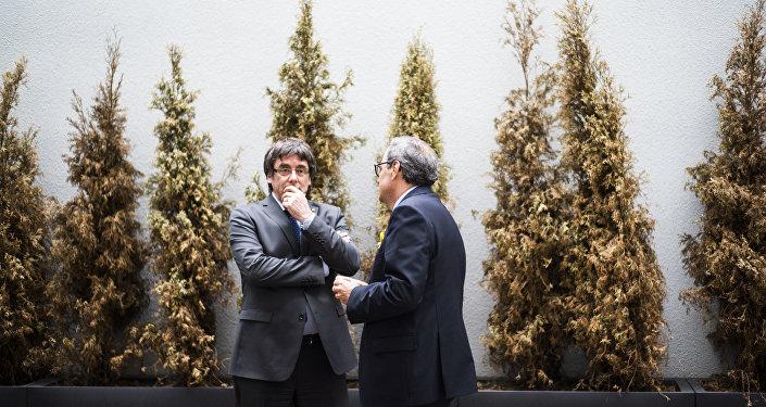 El expresidente de Cataluña, Carles Puigdemont, y el actual presidente del Gobierno catalán, Quim Torra