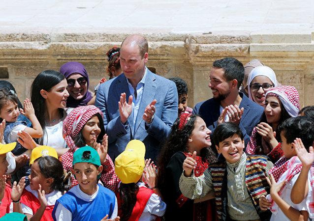 El príncipe Guillermo de Inglaterra con su esposa
