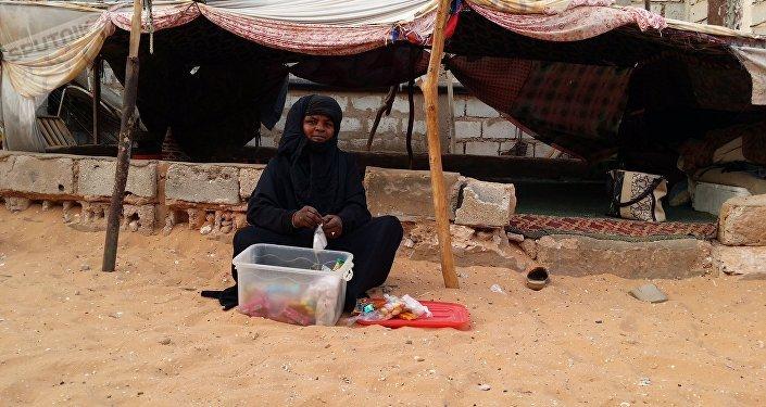 Shada, de 38 años, una criada y pastora de ovejas y de camellos de Mauritania