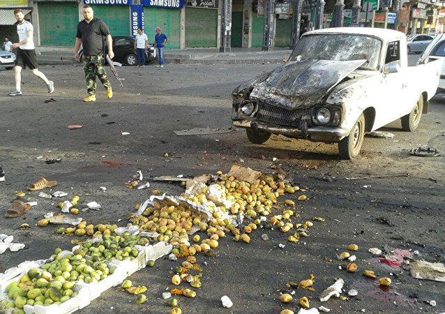 El lugar del atentado en el sur de Siria