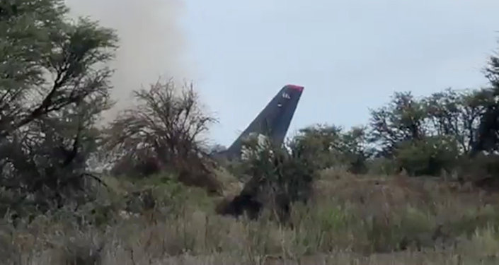 Smoke billows above an Aeromexico-operated Embraer passenger jet that crashed in Mexico's northern state of Durango