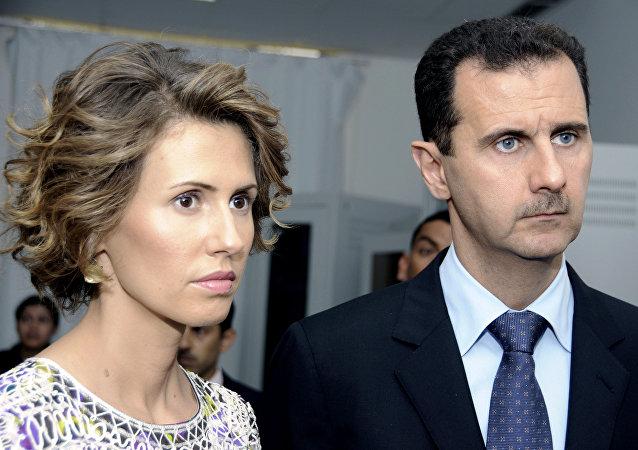 Asma Asad, primera dama siria, al lado de su marido, el presidente Bashar Asad