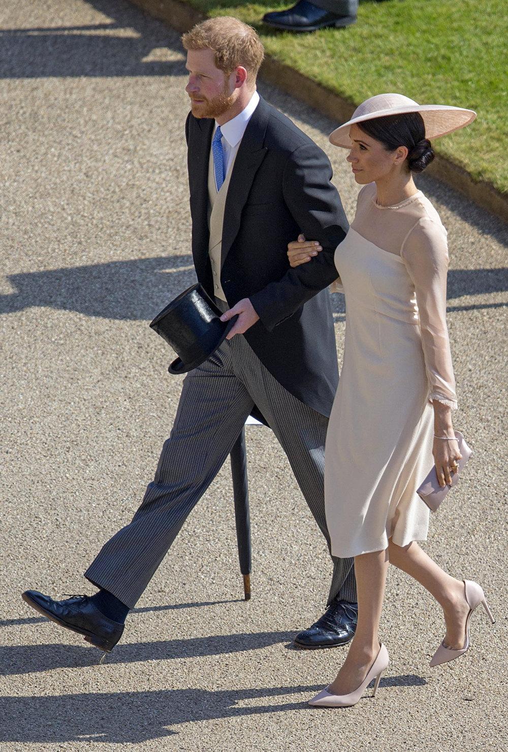 El príncipe Enrique y su esposa Meghan, la duquesa de Sussex