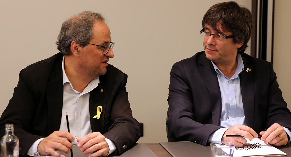 El presidente del Gobierno catalán, Quim Torra, y el expresidente de Cataluña, Carles Puigdemont