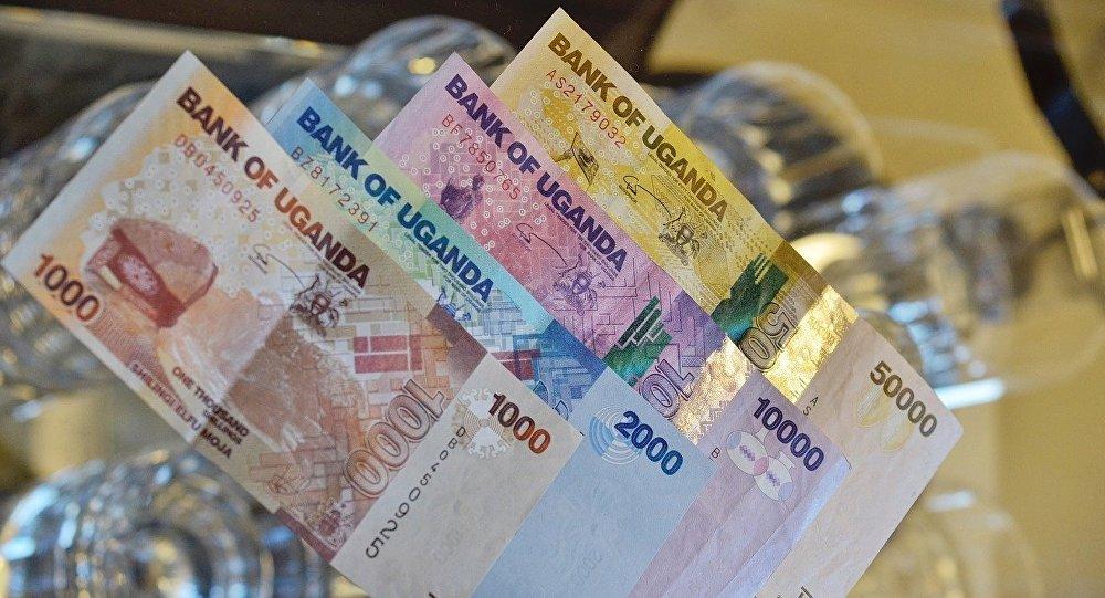 El dinero de Uganda, referencial
