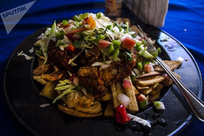 Pollo chuco preparado en el restaurante Honduras 504