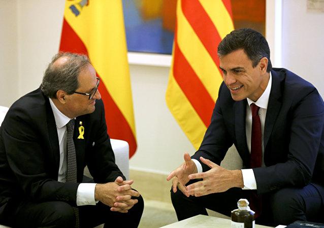 El presidente de la Generalitat, Quim Torra y el presidente del Gobierno español, Pedro Sánchez (archivo)