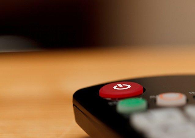 El botón de control remoto de un tele