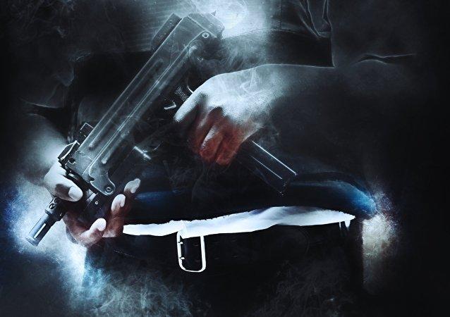 Un hombre con un arma (imagen referencial)
