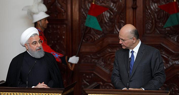 El presidente iraní, Hasán Rohani, con su homólogo iraquí, Barham Saleh