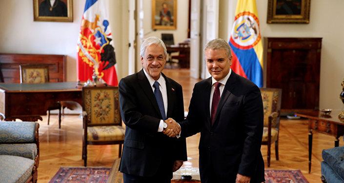 El presidente de Colombia, Iván Duque, y su homólogo chileno, Sebastián Piñera, en Santiago, Chile