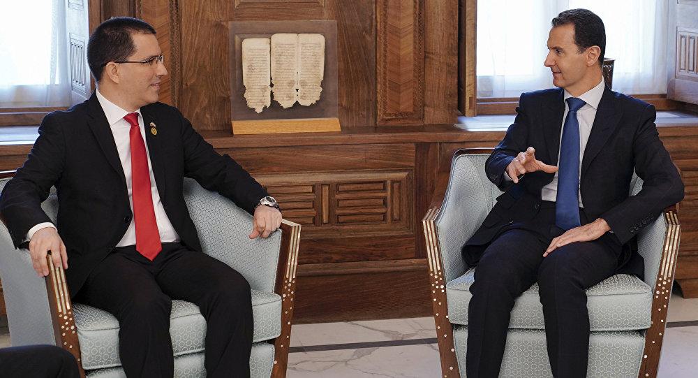 El canciller de Venezuela, Jorge Arreaza y el presidente de Siria, Bashar Asad
