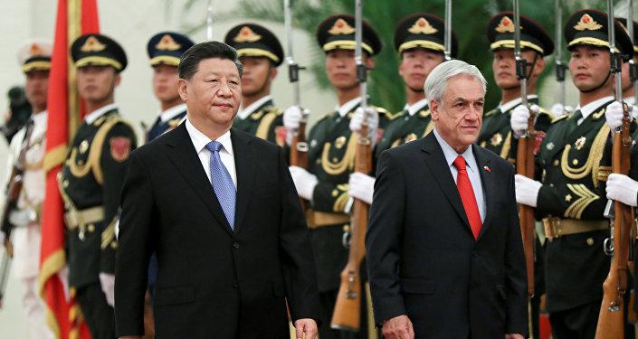 El presidente de China, Xi Jinping y el presidente de Chile, Sebastián Piñera