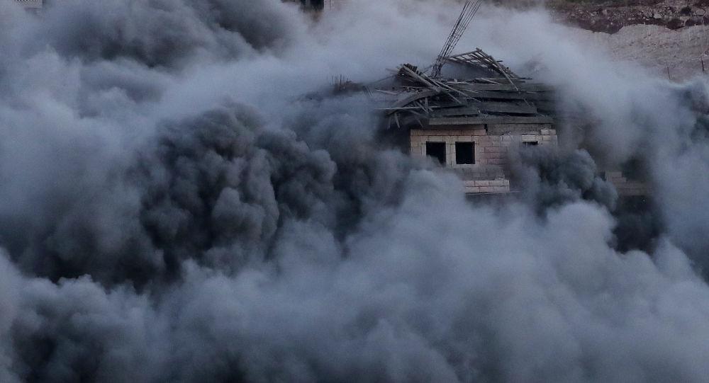 Un edificio palestino bombardeado por las fuerzas israelíes en la aldea de Sur Baher en la Cisjordania ocupada por Israel, el 22 de julio de 2019