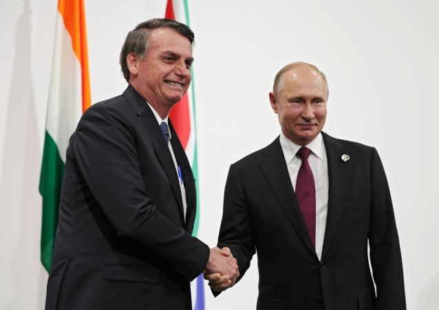 El presidente de Rusia, Vladímir Putin, con su homólogo brasileño, Jair Bolsonaro (archivo)