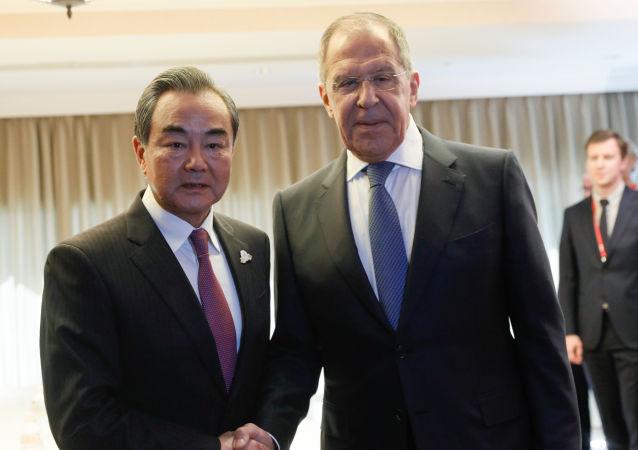 Canciller de China, Wang Yi, y canciller de Rusia, Serguéi Lavrov