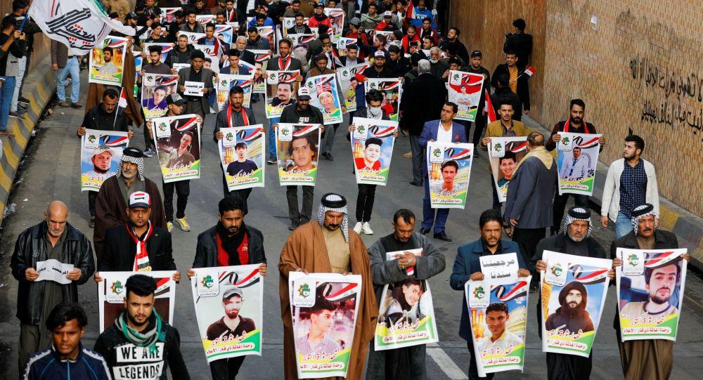 Retratos de los manifestantes muertos en Irak