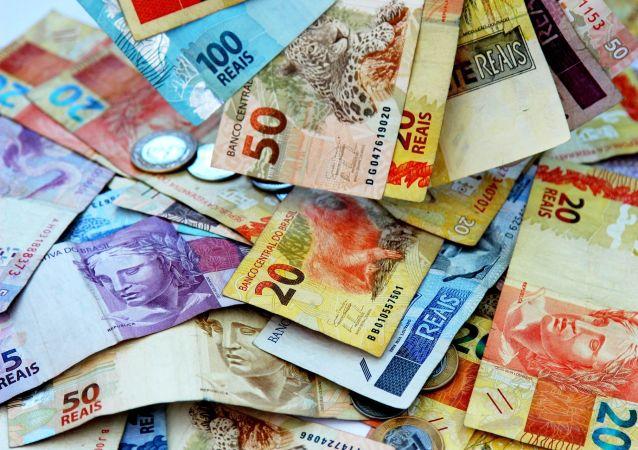 Billetes y monedas de real, la moneda brasileña