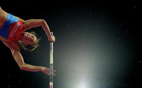 Российская спортсменка Елена Исинбаева во время финальных соревнований по прыжкам с шестом на XXX летних Олимпийских играх, август 2012.